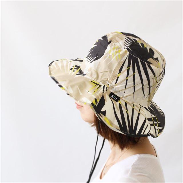 コスパの高い帽子をかぶった女性の画像